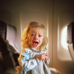girl-crying-on-plane